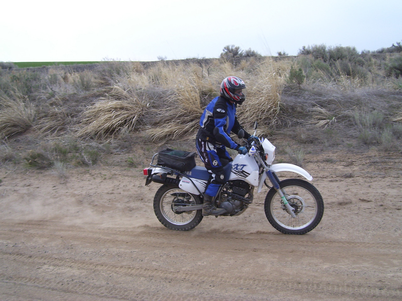 Sylvia on her XT 350. Check out her nice rack and bag to carry her chapsick in.