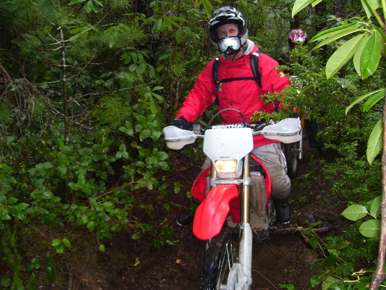 "Tod on his Honda CRF 250. This is on the ""H2O"" trail. He had an encounter with a Douglas-Fir tree back a few hundred feet."