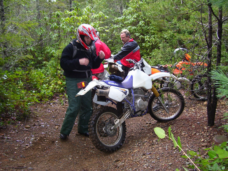 Once in a while it opens up. Taking a break here, Danny is about to take his helmet off I think. Marc is on the right and the orange is his plated KTM 300 EXC. Tod is behind Danny. I'll try to take more pictures next time.