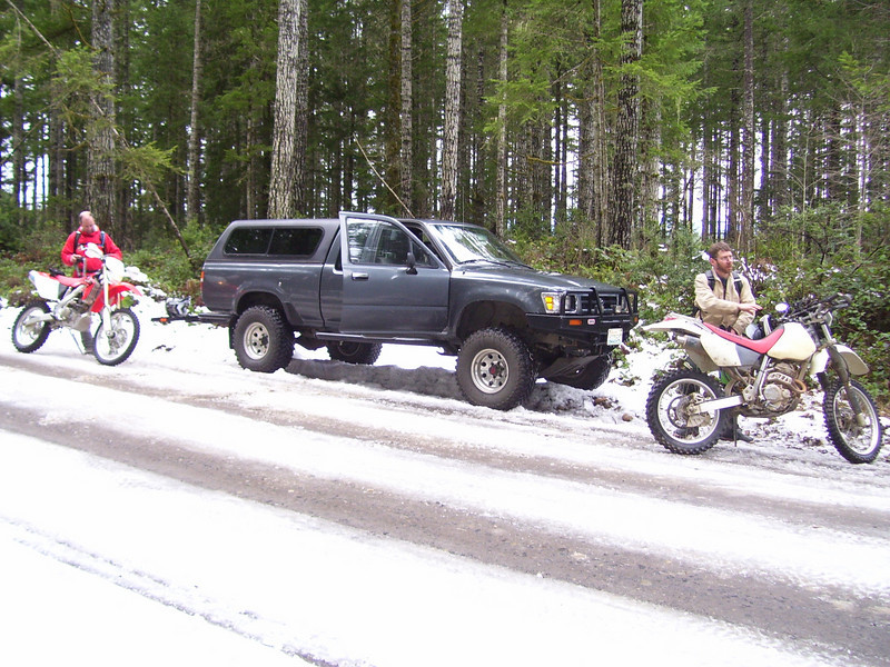 Our Polar Bear trail ride for New Years Day. Lots of snow in the Tahuya. Most of the main trails were closed so we went to Lan's Secret Forest. Tod and Jon getting ready after parking along the ____ road.