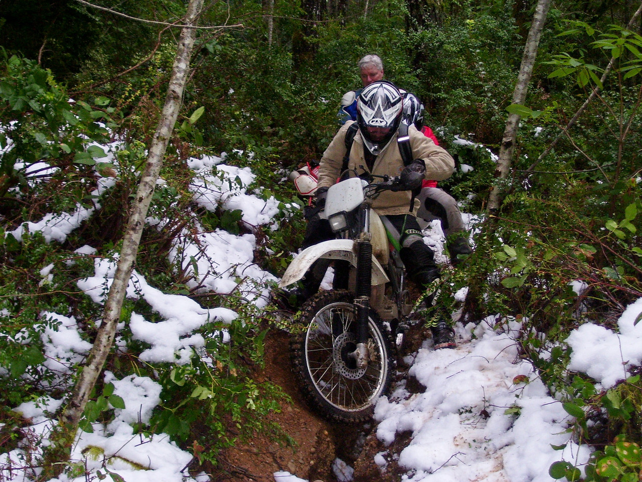 Jon inches his bike down the gouged out trail wondering if this is a good idea. We may have to turn around and come back up this mess.