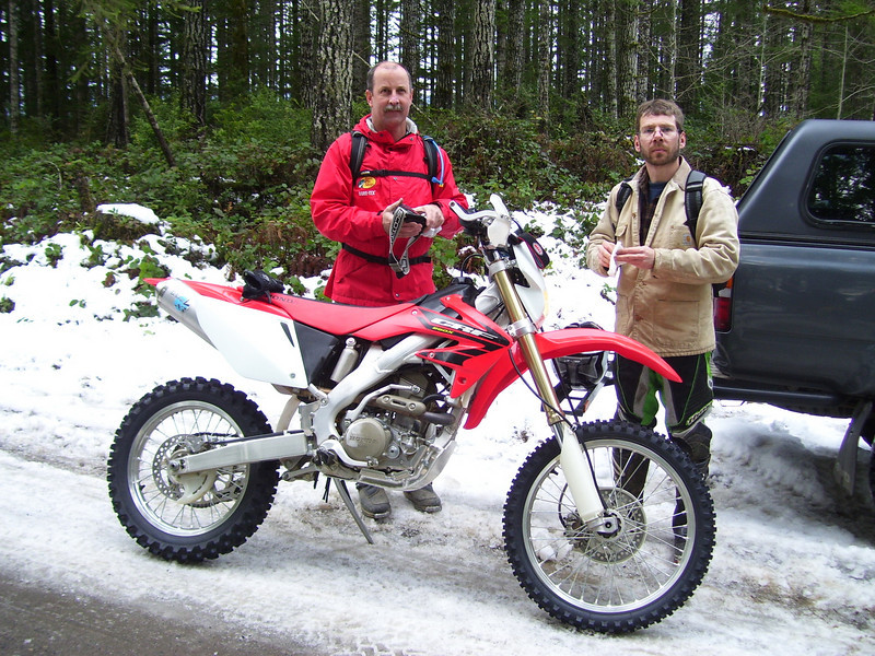 Tod's new CRF 250R. This was Tod's first time in the really tough stuff and he did great. The snow made it more challenging then ever. We were breaking ice in the puddles and fighting deep and narrow snow banks all day.