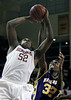 Rufus King's Bryon Brown goes up for a shot against Milwaukee Washington's Patrick Davis in the sectional semi-final game at the Al McGuire Center. Washington went in to the game undefeated but ended up losing to King 59-58. February 28, 2008.  (Milwaukee Journal Sentinel/GARY PORTER)