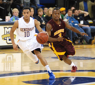 The full press was on as Milwaukee Rufus King's Marcus Kirk tailed by Chicago Marshall's Marquell Pierce at the Al McGuire Center in Milwaukee on Dec. 13, 2008. (Ernie Mastroianni for the Milwaukee Journal Sentinel)