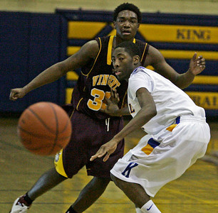 Vincent's Steve Stovall gets a pass off against Rufus King's Debonair Townsend during city conference game at King HS Friday, February 8, 2008  (Milwaukee Journal Sentinel/BENNY SIEU)
