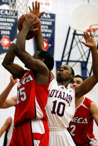 11/17/08 – BELLEVILLE, ON – Loyalist Lancer Patrick Kalala, right, makes an attempt to stop Seneca Sting Jonathan Goulbourne's lay up. The Lancers lost 53-60. (Photo by Paula Trotter)
