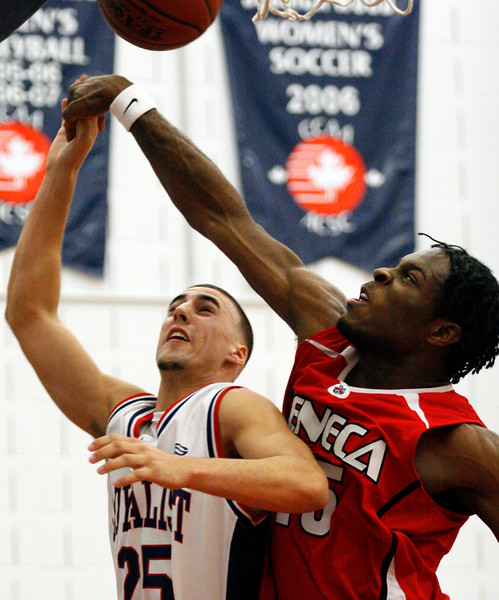 11/17/08 – BELLEVILLE, ON – Loyalist Lancer Scott Maycock's shot is blocked by Jonathan Goulbourne of the Seneca Sting, right. The Lancers, who lost 53-60, need to beat the Georgian Grizzlies on Sunday afternoon to record their first win of the season. (Photo by Paula Trotter)
