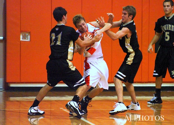 Hanover Nighthawk Jordan Martz gets tangled up by Delone Catholic Squires Mark Staub (21) and Cody Smith. From 2008 12 12 Basketball.