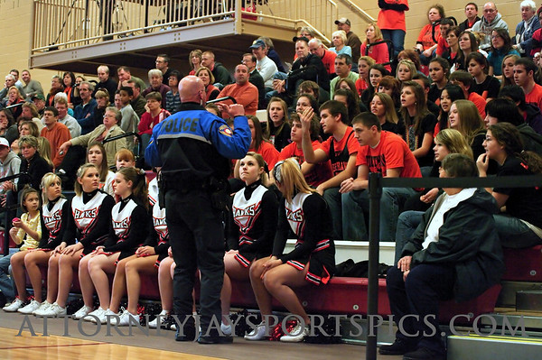 The Nighthawks fans tried to storm the court after a ref's bad call so the cops had to be called. :-)  Just kidding.  Maybe somebody can leave a comment explaining what this was about.