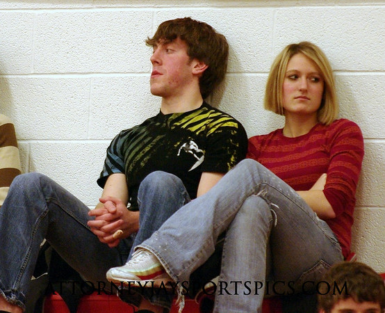 Former Eagle football and basketball star Adam Stroup enjoys the game with a friend.