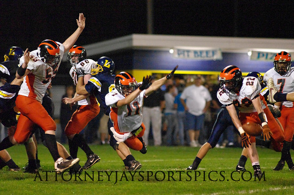 Hanover Nighthawks Tyler Yohe (55), Colton Dils (11). and Payton Caler (22) combine to block the Littlestown Thunderbolts extra point attempt. From 2009 09 18 Littlestown 42 Hanover 8.