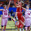 Bermudian Springs Eagle Aaron Huntington sails past New Oxford Colonials' defenders Ross Starner (20) andMarc O'Brien(44).  From Basketball 2010 12 28 .