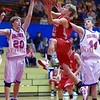 Bermudian Springs Eagle Aaron Huntington sails past New Oxford Colonials' defenders Ross Starner (20) and and unidentified no. 44 (please comment if you can ID no. 44).  From Basketball 2010 12 28 .