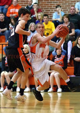 This and next photo, Hanover Nighthawk Pete Yingst drives past York Suburban Trojan Ted Hinnenkamp for the basket. From Basketball 2010 01 19 York Suburban 54 Hanover 37.