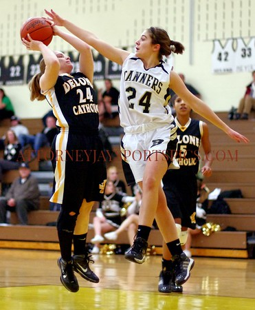 Delone Catholic #24 Courtney Riggs and Biglerville's Olivia Moore. From Basketball 2010 01 05 Delone Catholic 59 Biglerville 22
