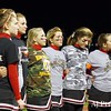 Mustang cheerleaders bow in a moment of silence for number 81, Ben Bynaker. Wearing camo clothing to remember Ben.