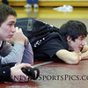 The Mustang wrestlers take a break between tournament rounds.