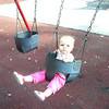 Mackenzie swings herself at 10 months part 1
