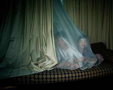 Kids hiding behind curtain