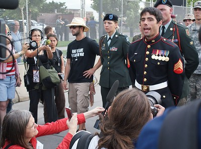 News media, including Amy Goodman from Democracy Now, interview a Marine Corps sergeant and other members of the military, who were part of a march against the Iraq war, at the 2008 Democratic national Convention in Denver.
