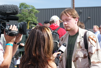 Young Army veteran opposed to the Iraq war being interviewed by the media at an anti-war march at the 2008 DNC in Denver.