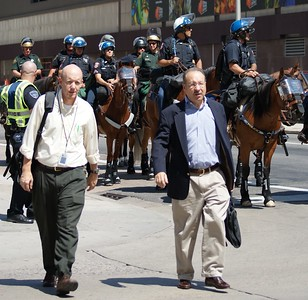 Delegates to the 2008 DNC in Denver walk past police on horseback.