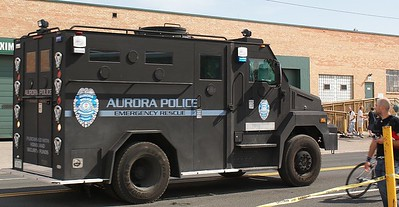 "Armoured police vehicle with ""Aurora Police"" on the side."