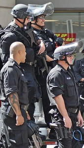 Police in  riot gear, share a laugh while on duty at the 2008 Democratic National Convention, in Denver, Co.
