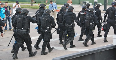 Police in riot gear, marching in formation while on duty at the 2008 Democratic Convention in Denver, Co.