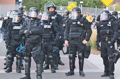 Police sergeant with group of other police officers, in riot gear, on duty at the 2008 Democratic Convention in Denver.