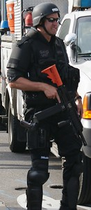 Police officer in riot gear, armed with automatic weapon, on duty at the 2008 Democratic National Convention, in Denver, Co.