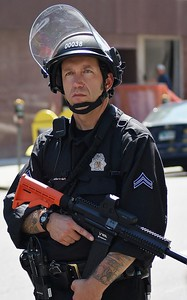 Police officer armed with automatic weapon, on duty at the 2008 Democratic Convention in Denver, Co.