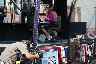MSNBC reporter Norah O'Donnell interviews a guest on an outdoor set at the 2008 Democratic National Convention in Denver.