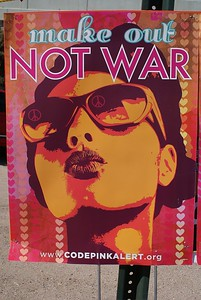 """Make Out Not War"" poster displayed at 2008 DNC in Denver."