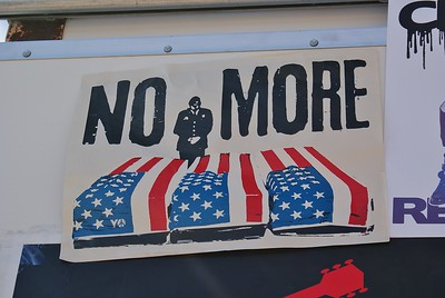 Anti Iraq war poster depicting flag draped coffins.