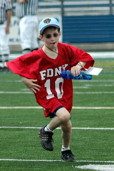 Son of Patty Lyons quaterback for the Bravest until 9/11<br /> His spirit still runs free on the field !
