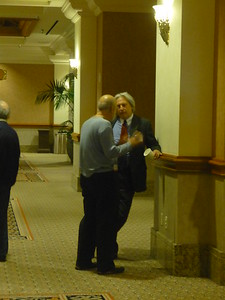 Stewart Feldman and Sandy Poger continue discussion after his presentation on Captive Insurance