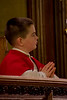 Grotto altar boys will wear the celebratory white cassock and red shoulder capes throughout the Christmas season.