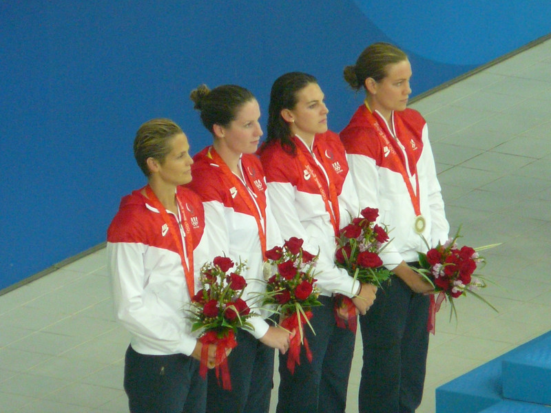 Natalie on far right, Dara Torries on far left, silver 4X100 freestyle relay