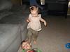 Abby trying to step on Aidan..naughty girl!