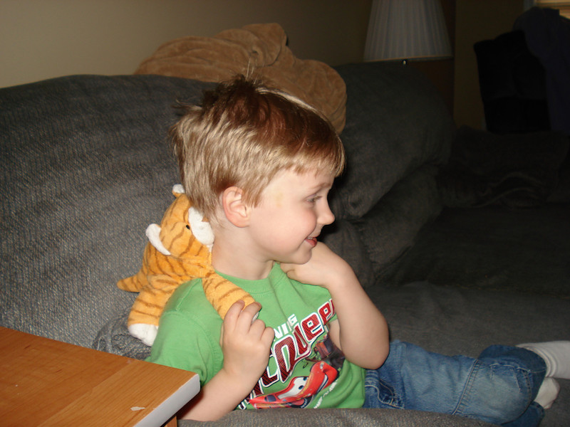 Aidan giving Tiger (a stuffed tiger he's slept with since he was a baby) a piggy back ride!