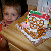 Aidan poses for a pic of the gingerbread house they made at school.  He did a great job!