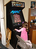 Sophia playing Ms Pac Man