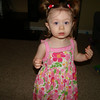 Cutie girl!  I made those clippies to match her dress.  :)