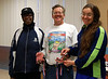 Team MCRRC DRAGONS, represented by Betty Smith and Christina Caravoulias, accept their medals from George Washington's Birthday Marathon Relay director Bob Platt.         Photo by Mark Zimmerman