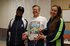Betty Smith & Christina Caravoulias accept the Women Masters Team third place prize for Team MCRRC Dragons from Relay Race Director Bob Platt         Photo by Mark Zimmerman