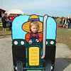 Aidan reluctantly taking a picture at the berry farm when we went for the halloween stuff
