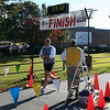 Me finishing with a new PR for the 10K.