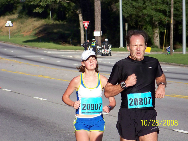Dave stays a step ahead of 16-year-old Megan Breitbach.  She was 1st Female with a time of 19:18.  Dave won his age group.