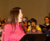 Liz Wittman sings, John is visible in background